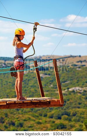 Young Woman Are Ready To Descend On Zipline In Mountain, Extreme Sport