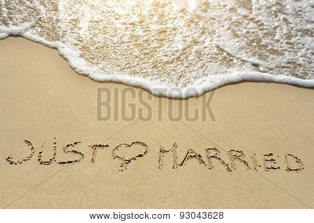 Just Married Written On Sand Beach Near Sea