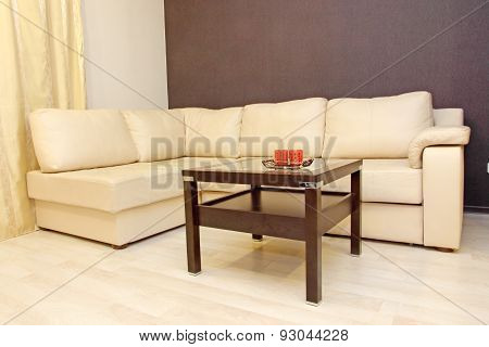 Comfortable White Leather Corner Sofa With Coffee Table.