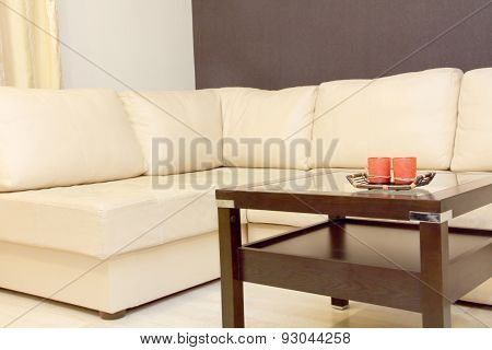 Interior With Coffee Table And White Corner Leather Sofa .