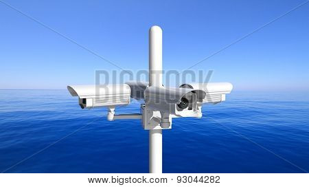 Security surveillance cameras on blue sky and sea background
