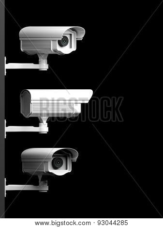 Three security surveillance cameras side view isolated on black background