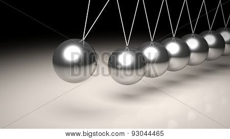 Newton's cradle closeup abstract background