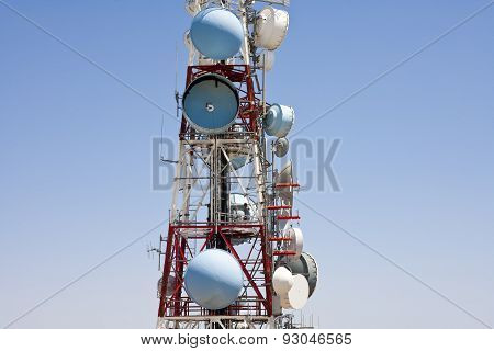 satellite dishes and telecommunication tower against sky