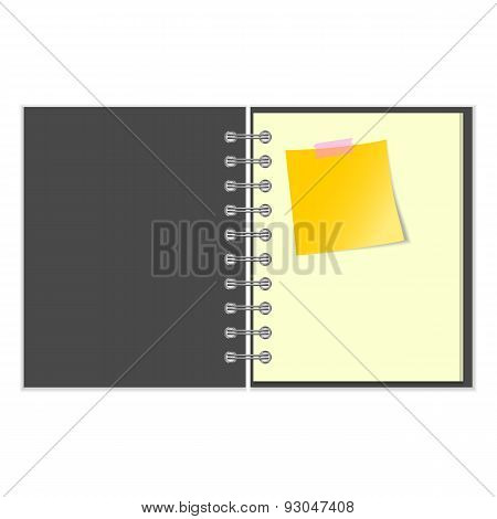 Open grey cover notebook with yellow sticker