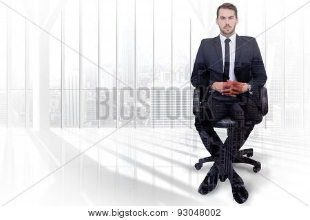 Stern businessman sitting on an office chair against high angle view of city