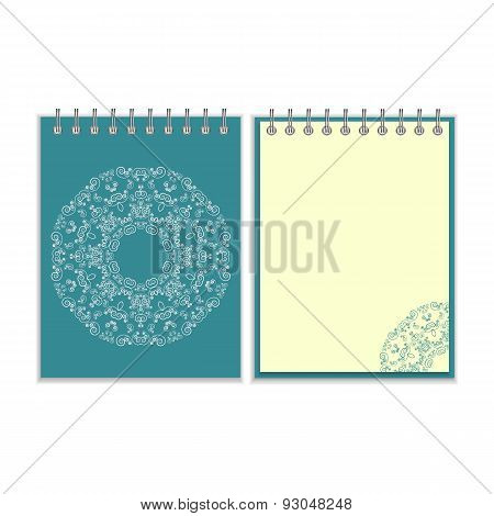 Blue cover notebook with round ornate pattern