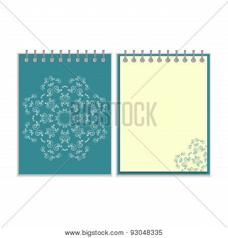 Blue cover notebook with round ornate star pattern