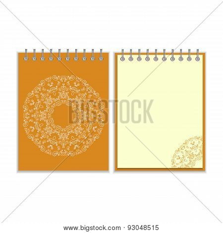 Orange cover notebook with round ornate pattern