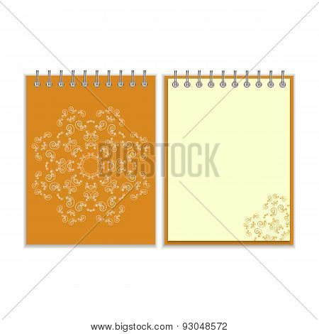 Orange cover notebook with round ornate star pattern
