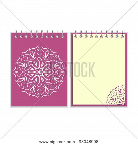 Purple cover notebook with round florwer pattern