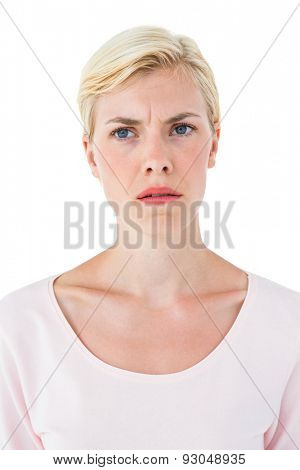 Doubtful blonde woman on white background