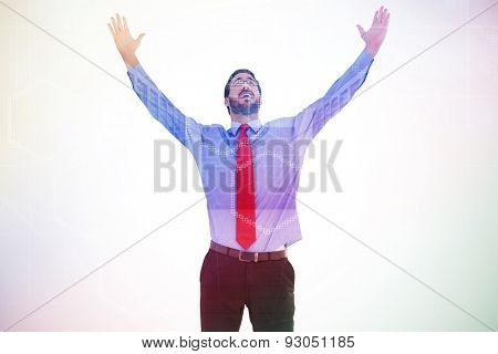 Happy cheering businessman raising his arms against server room with towers