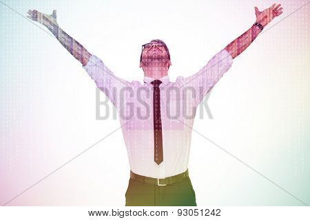 Cheering businessman with his arms raised up against server room with towers