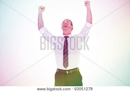 Handsome businessman cheering with arms up against server room with towers