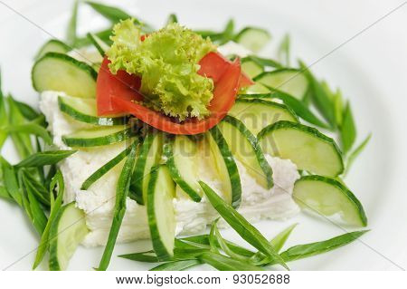 Vegetable Salad With Cucumbers, Lettuce, Tomatoes And Cheese