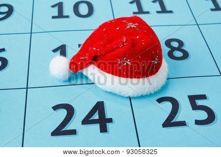 Cap of Santa Claus on the calendar