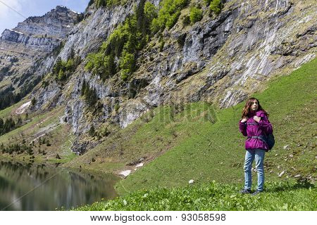 Woman Hiking On Mountains