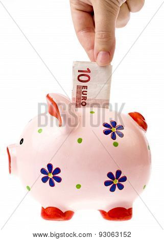 coin bank and euro currency banknote