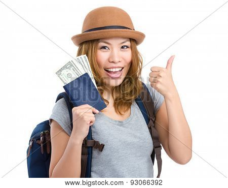 Young girl with thumb up and holding passport with money