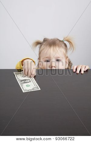 Baby Looking At Camera Taking Dollar