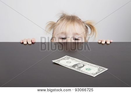 Baby Looking At Dollar Banknote Horizontal