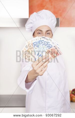 Wad Of Euro Banknotes In Woman Chef Hands