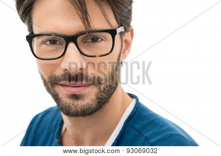 Closeup of smiling young man wearing eyeglasses