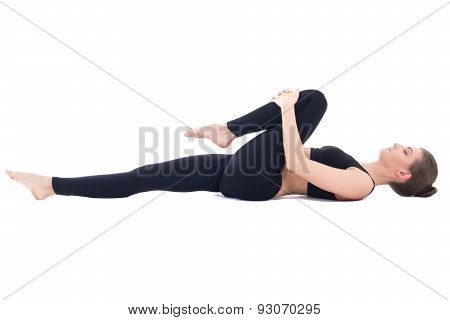 Beautiful Sporty Woman Lying And Doing Stretching Exercise Isolated On White