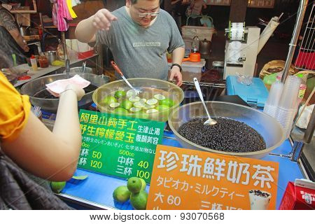 Taipei, Taiwan - May 15th 2015: Raohe Night Market stall selling the most popular Taiwanese drinks, bubble tea and aiyu jelly.