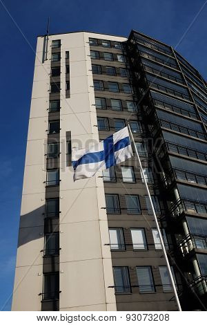 Fluttering National Flag Of Finland Beside Modern Building