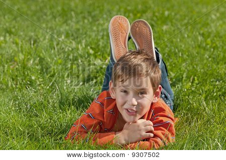 Surprised Boy On The Meadow