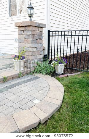 Circular Brick Step Onto An Outdoor Patio