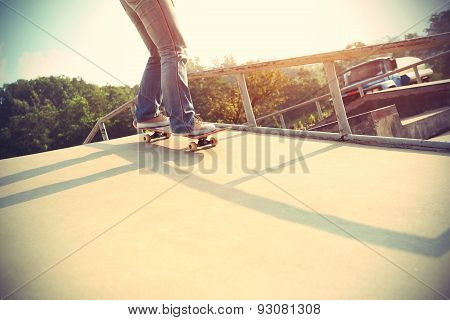 skateboarder riding on skateboard at skatepark ramp