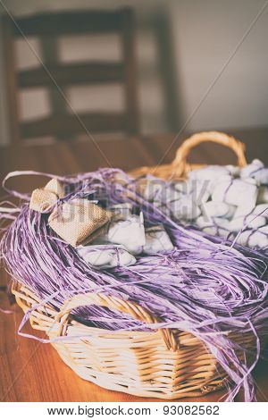 Basket With Purple Raffia, Confetti And Jute Sachet