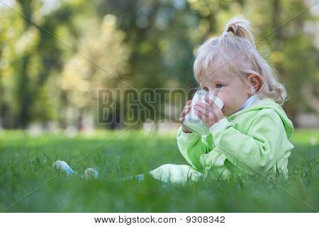 Serious Little Girl Drinking Milk
