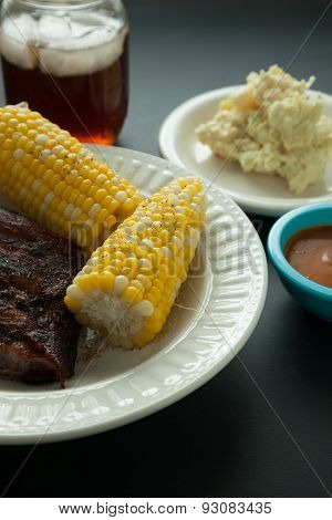 Barbecue Pork Spare Ribs With Corn And Potato Salad