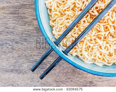 Spicy Instant Noodles In Bowl With Chopsticks
