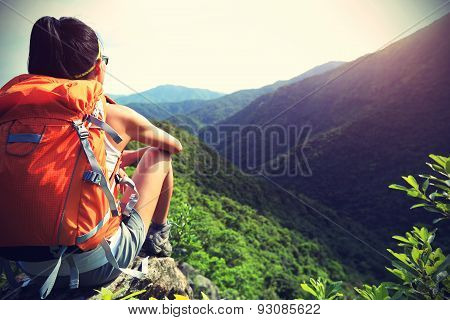 young woman hiker enjoy the beautiful landscape mountain peak