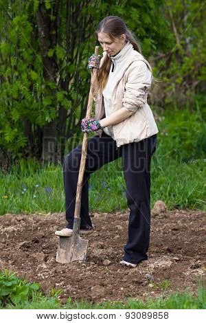 Woman Digging In The Garden