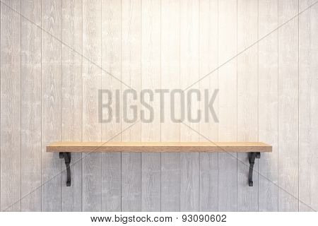 empty book shelf on wooden wall
