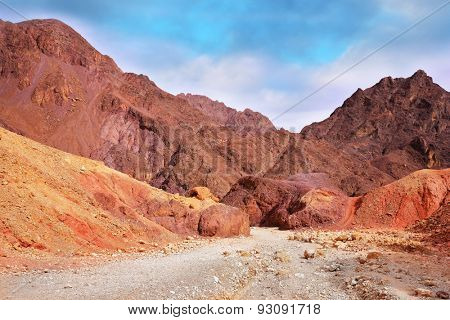 Warm day in January. Multi-colored mountains of Eilat, Israel. The road to the