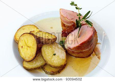 Roasted pork tenderloin with bacon, roasted potatoes