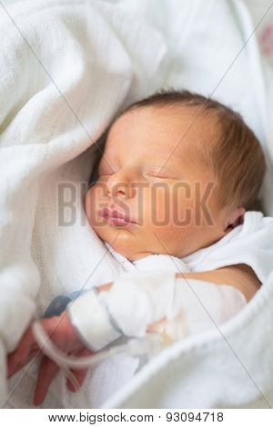 Newborn baby boy in the hospital after c-section