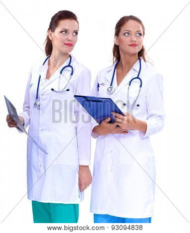 Two woman nurse watching X Ray image, standing in hospital.