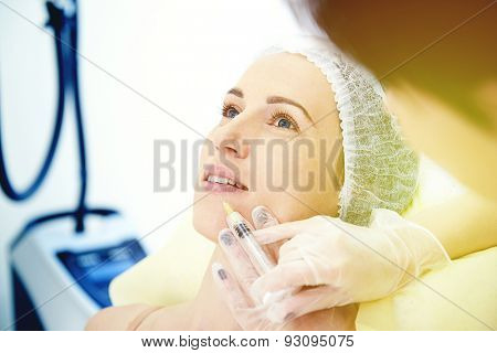 doctor doing injecting for lips augmentation