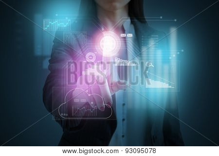 businesswoman pressing on cloud computing on virtual screen over dark background
