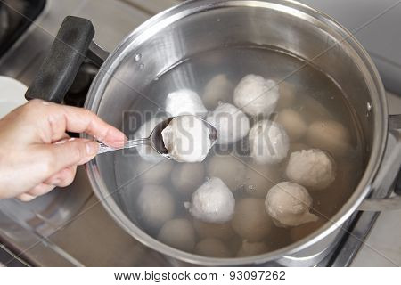 Fish ball on the boiled water inside the pan