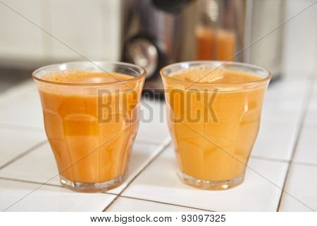 Two glass of carrot juice on the table