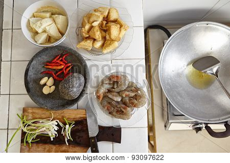 Preparing ingredient to cook spicy stir fried shrimp tofu